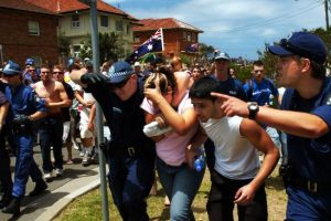 The couple were rushed to safety behind police lines. Picture: Craig Greenhill