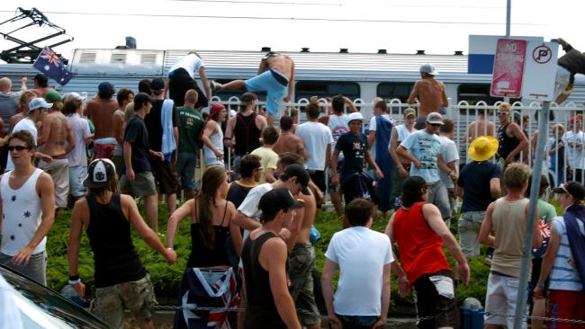 Hundreds of people jumped the fence to storm the train station. Picture: Craig Greenhill