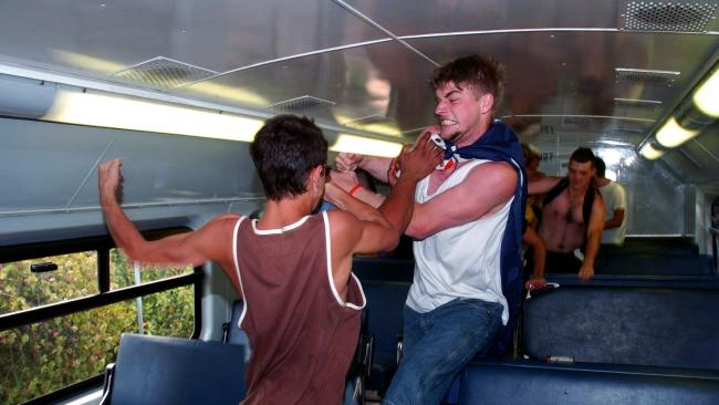 Thugs rushed into the top carriage to attack two young men waiting on the train. Picture: Craig Greenhill