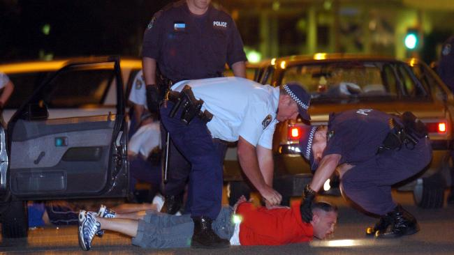 Police arrest men of who were driving into Cronulla armed in response to the train bashing. Picture: Craig Greenhill