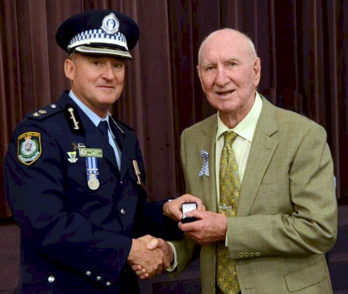 Superintendent Peter Thurtell & Cecil Maloney Receiving a Retired Police memorial pin - Taree Police - September 2014