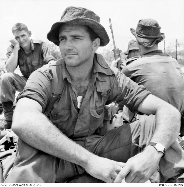 Bien Hoa, Vietnam. 1965-07. Private Peter Dorter of Perth, WA, relaxes at the edge of the airfield after an operation by the 1st Battalion, The Royal Australian Regiment (1RAR).