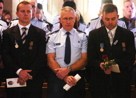 Ferny Grove Police station officers who worked with Constable Brett Andrew Irwin during the officer's funeral at the St Stephens Cathedral. Picture: AAP/Tony Phillips
