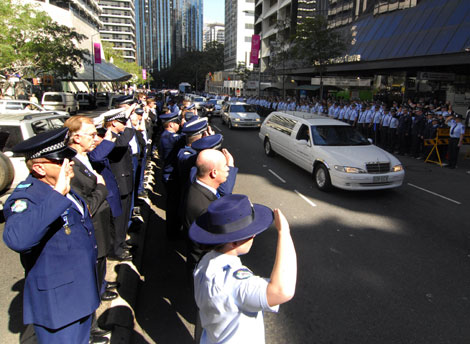 Queensland Police line the streets in a guard of honor for Constable Brett Andrew Irwin while his casket is escorted from the St Stephens Cathedral in Brisbane. Picture: AAP/Tony Phillips