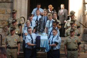 Collegues of Constable Brett Andrew Irwin carry his casket from the St Stephens Cathedral. Picture: AAP/Tony Phillips