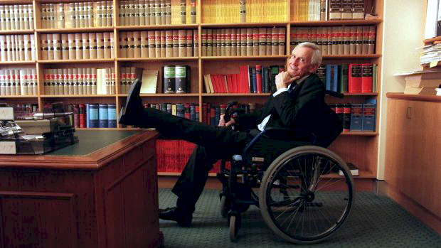 Acting Judge Donald Stewart at work after losing his feet to gangrene. Photo: Steve N Siewert
