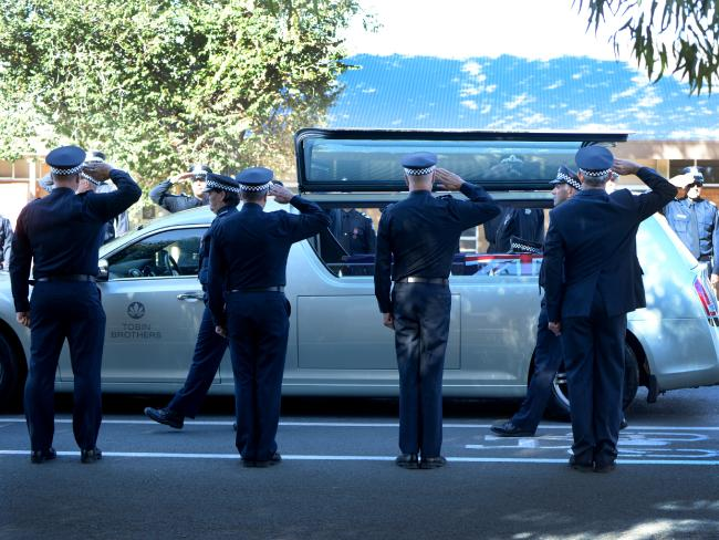 Victoria Police officers form a guard of honour at Ray McNish's funeral. Picture Lana Murphy /Riverine Herald