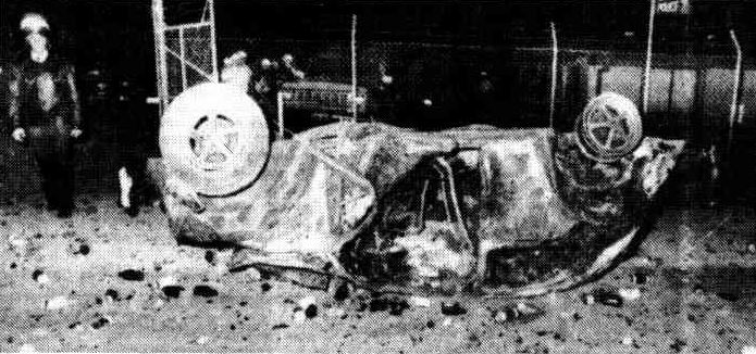 The burnt-out remains of the Volkswagen which was rolled against the police compound by motor-cyclists at the beginning of the riot on Saturday night.