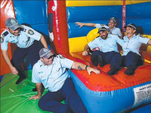 Senior Constable Jay Stewart and colleagues Graham Smith, Mick Errickson, Karen Bertram and Steve Bancroft warming up for their Guinness Book of World Records attempt for continuous jumping on a jumping castle.