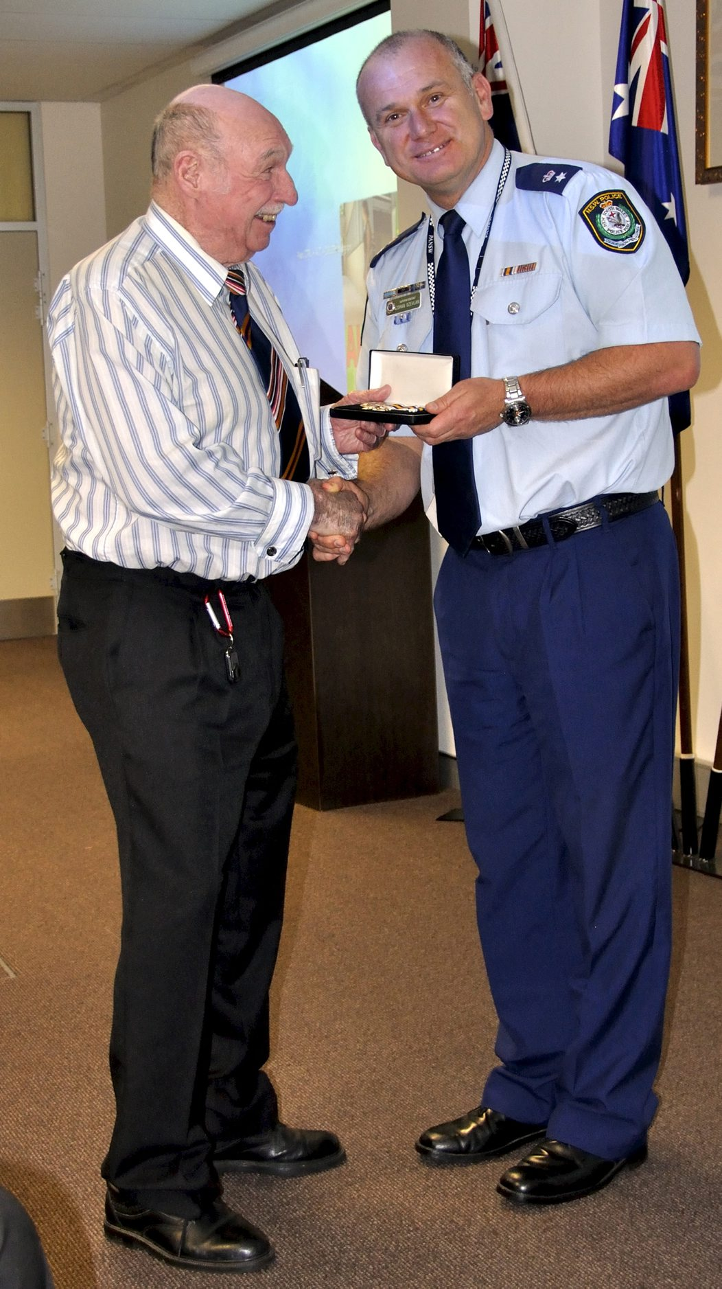 Sid AXAM receiving his National Police Service Medal at Retired Police Day - Lake Illawarra Police Station on 8 September 2016 by acting Local Area Commander, Supt. Zoran Dzevlan.