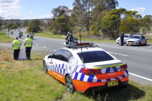 POLICE ON THE SYDNEY ROAD, GOULBURN, AT THE LOCATION THAT CONSTABLE SHELLEY DAVIS LOST HER LIFE WHILST ON DUTY.