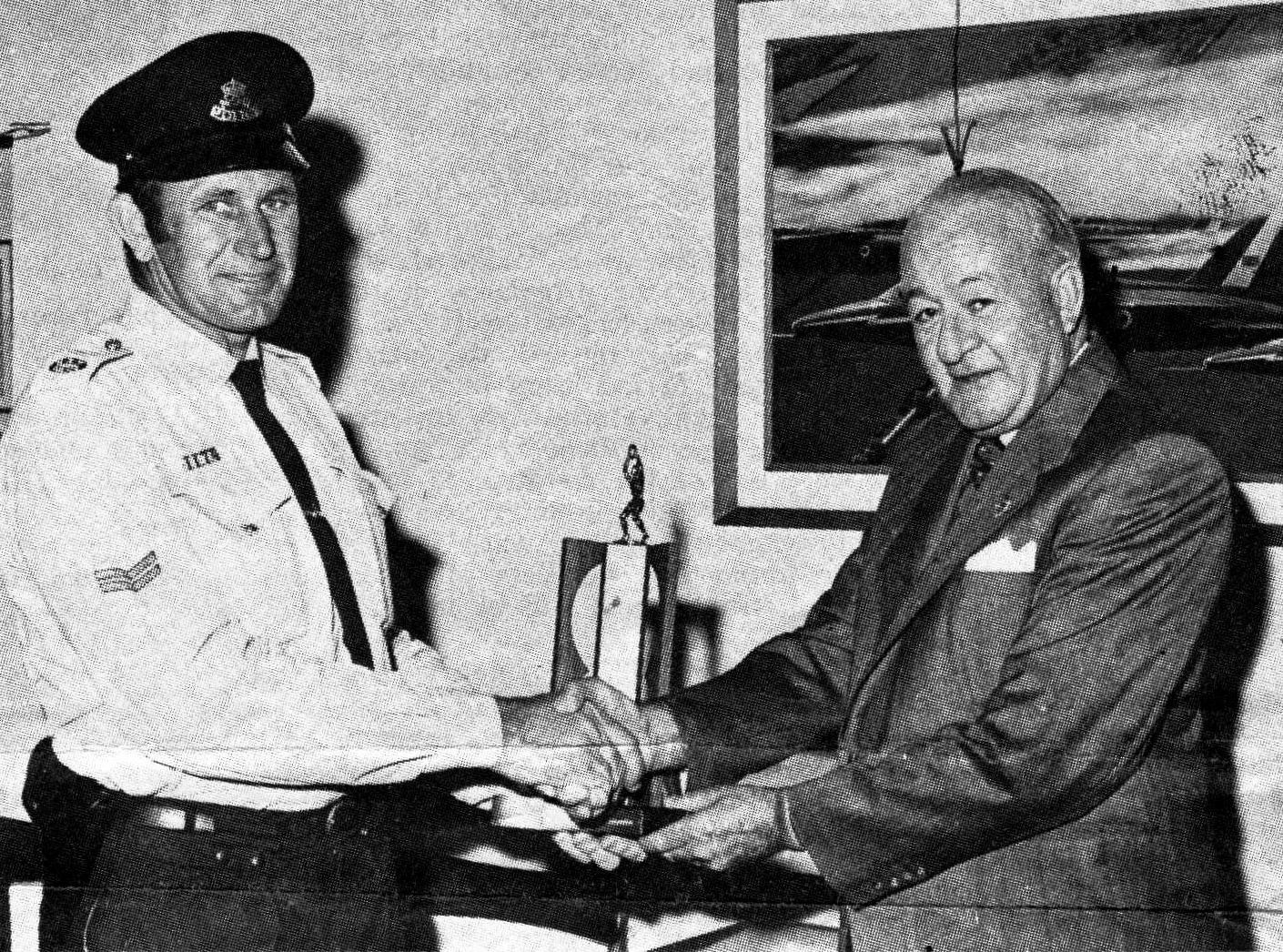 Our photograph shows Sgt Ellis Noack presenting the 1972 premiership Trophy to the then patron of the club, NSW Police Commissioner, Fred Hanson.
