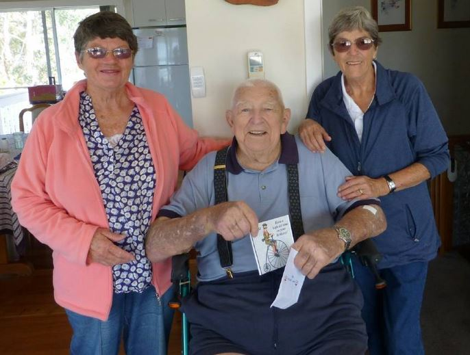 BIRTHDAY BOY: Sue Cotterill and Wendy Dunn help long-time Tathra resident Fred Pitchford celebrate his 92nd birthday on October 28 with family and friends.