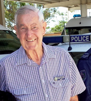 5 March 2015 Police Dog Unit handler Senior Constable Mark Baxter with former Senior Sergeant at the Coffs Harbour Police Station Garry Clancy and his wife Beverley.