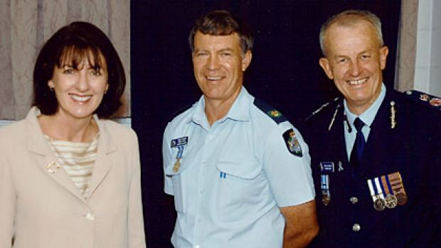 Senior Sergeant Mick Isles (centre) with former state Police Minister Judy Spence and Queensland Police Commissioner Bob Atkinson.