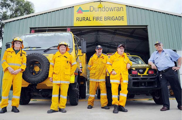 Dundowran Rural Fire Brigade's David Kohler, Dave Spawton, Keith Speirs, Peter O'Brien and Hervey Bay District Rural Fire Group chairman Denis Dack are losing their funding.