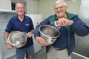 Fraser Coast Meals on Wheels president Ray Fleming and Community Help Group fundraiser Denis Dack will be whipping up some great bargains out of the old kitchen on Gossner St in Scarness. Alistair Brightman
