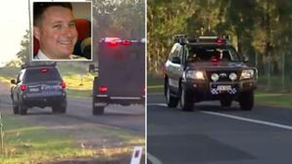 Pictured: Cop shot dead as he tried to escape crashed police car. Source: 7 News