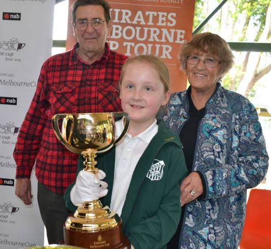 CUP: Maddy Jackson with her grandparents Dee and Dennis Matts at the 2015 Emirates Melbourne Cup visit to Terara Public.