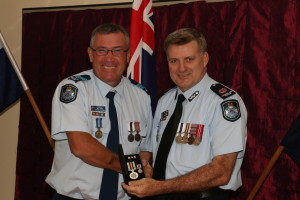 Sergeant Owen Harms OIC Miriam Vale receives his award from the A