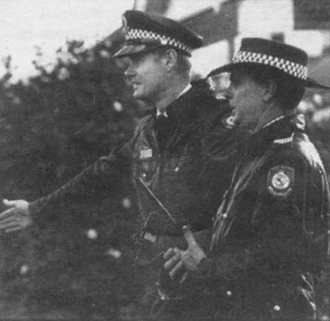 Neville Archer & Phillip Stephenson directing traffic near a siege in Dubbo in the late 1990's.