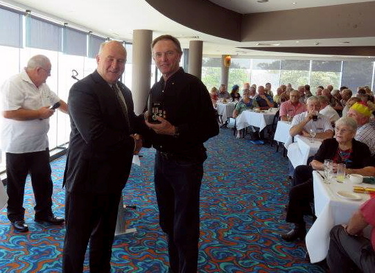 Photo of Bruce receiving his NSW Police medal at Ballina RSL Club 2 years ago from Superintendent Greg Martin.