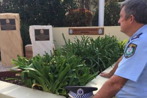 NOT FORGOTTEN: Blacktown Police Chief Inspector Bob Fitzgerald pays his respects at a memorial to slain officers Sergeant 1st Class William Riley and Sergeant 3rd Class Maurice McDiarmid. Picture: Harrison Vesey