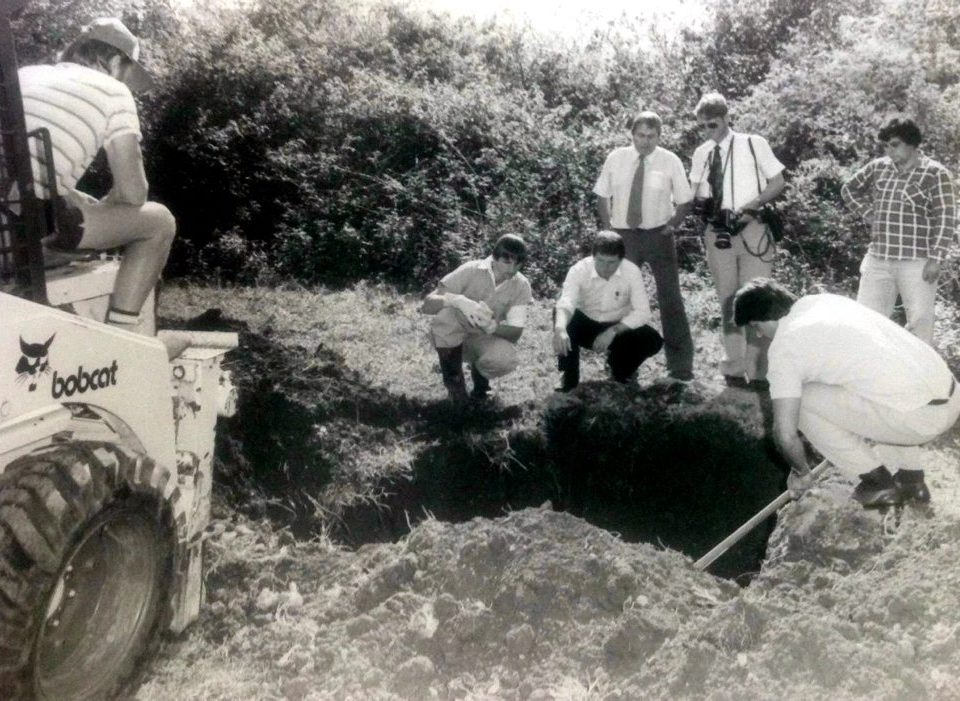 "Looking for "" Fine Cotton "" Det.Sgt. Douglas Cecil Bentley ( crouching with black pants ), Det. Sgt. Carl Cameron ( standing behind Bentley ) & Allan Tutt ( crouching with shovel ), exhuming a horse, not Fine Cotton in that hole."