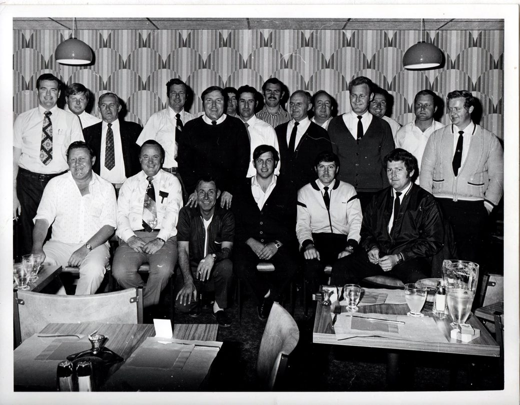 Police Association meeting at the Broken Hill Musicians Club 1977.<br /> Back Row. L to R<br /> Neil Stewart, Dave Stuart, Reg Pinkerton, ?, Ken Richards, Bob Morgan (mostly obscured) Terry Picker, Don Forsyth, Jim Brown, Barry Esling, Bryce Farlow, Allan Moseley, ?, Neville Wenban.<br /> Front Row. L to R.<br /> John Sylvester Wilkinson aka Yogi, ?, Bill Lidden aka Truthfull (?), Steven Behsmann, Garry Nowlan & Neil Scarr.<br />