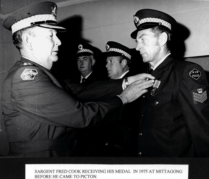 SARGENT FRED COOK RECEIVING HIS MEDAL IN 1975 AT MITTAGONG BEFORE HE CAME TO PICTON.