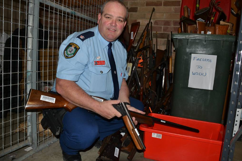 2017: Shoalhaven Local Area Command Chief Inspector Steve Johnson with some of the guns surrendered locally during the gun amnesty.