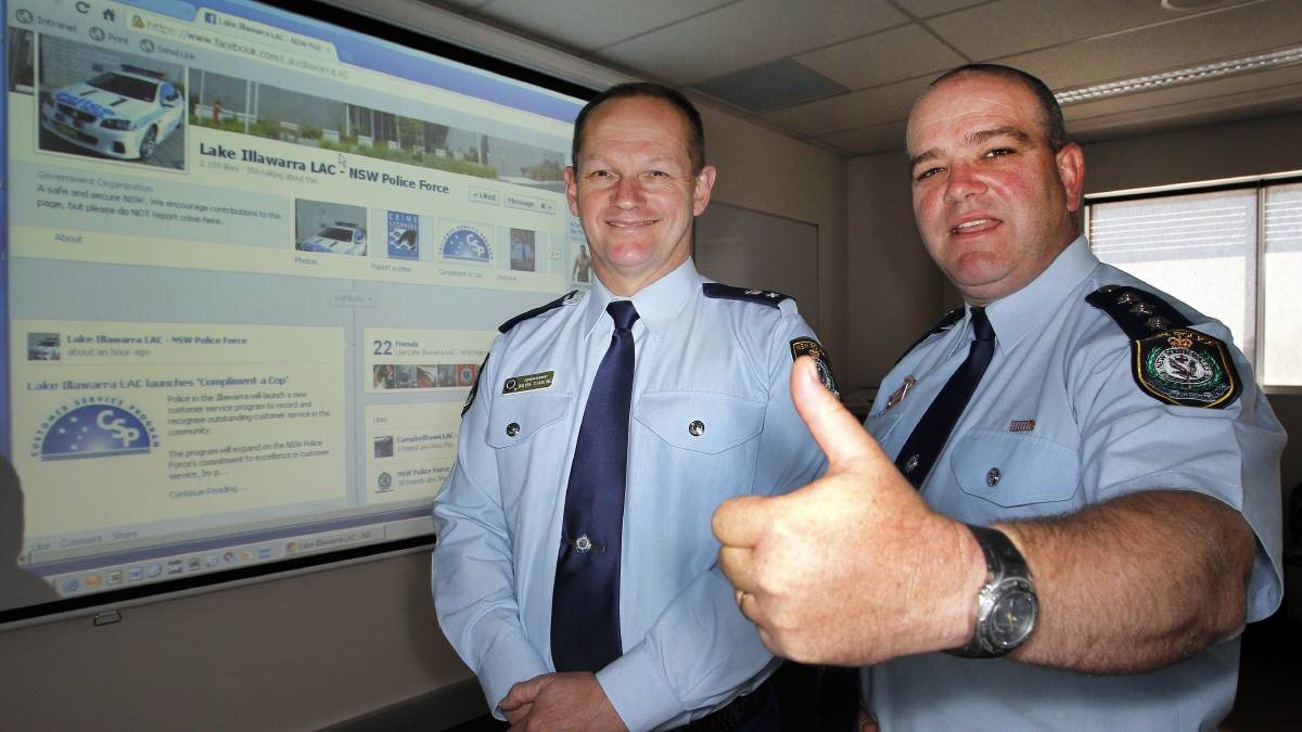 On the job: Superintendant Wayne Starling, left, with Inspector Steve Johnson - promoting Compliment a Cop through social media sites in 2012.<br />