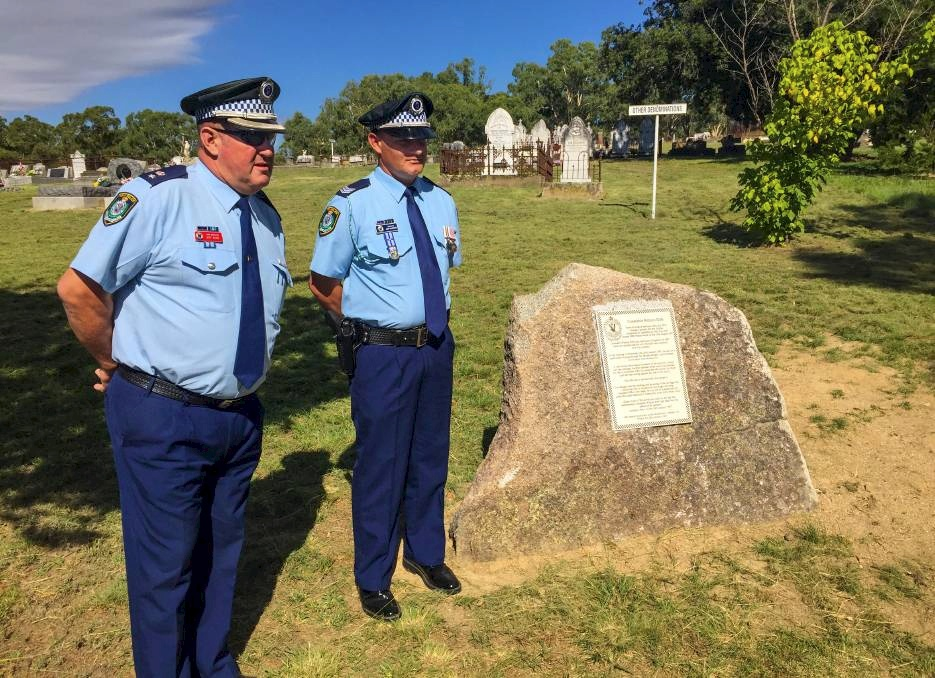 Memorial service: Oxley Acting Superintendent Jeff Budd lays a wreath at the unveiling of the plaque at the Bendemeer cemetery. Photos: Breanna Chillingworth<br /> Memorial unveiled: Oxley Acting Superintendent Jeff Budd with Sergeant Josh McKenzie in Bendemeer.<br />