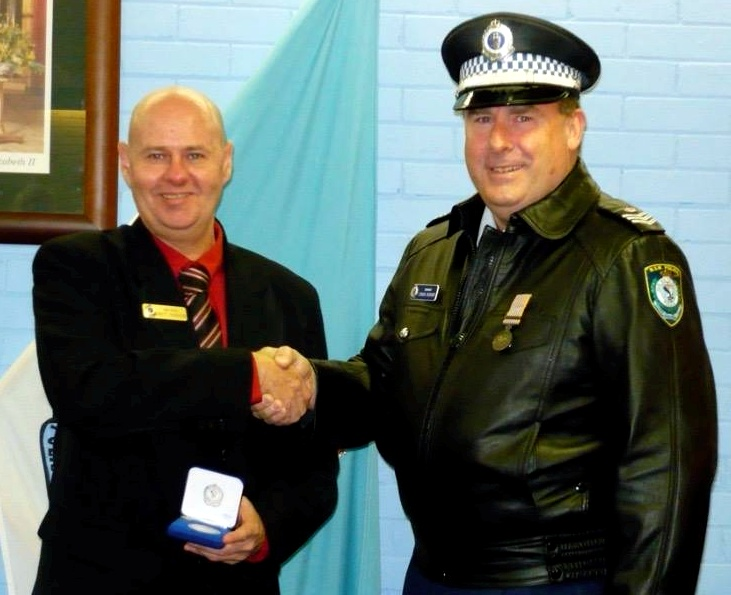 Brett being presented his NSWP Medallion - 10 years, by Sgt 2/c ( Ret. ) Craig Bishop - Head of Academy Security.