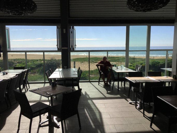 Retired NSWPF member Hugh Hargreave, who worked with Nutty at Terrigal, sitting inside the restaurant at Wamberal Surf Club - reminiscing about his mate <br />