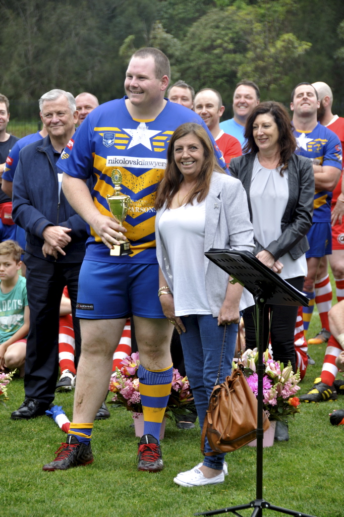Amanda presenting the Col Stevenson Trophy to ? at the 2017 Illawarra Police Memorial footy game.