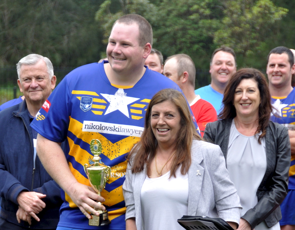 Amanda presenting the Col Stevenson Trophy to ? at the 2017 Illawarra Police Memorial footy game. Retired Commissioner of NSW Police - Ken Moroney to left. Police Widow - Kerri Donnelly to the right