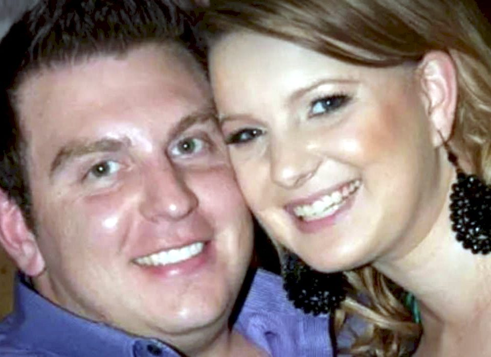 Australian Joshua Paroci, pictured with his wife, who is also a police officer.