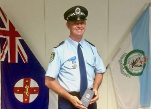 UNEXPECTED AND TRAGIC: Serving and retired police officers were among the mourners at the Dubbo funeral of Detective Senior Constable Peter Ensor who died in Fiji on April 4. Photo: Contributed