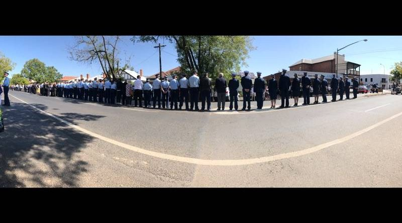 A guard of honour forms after Peter Ensor's funeral on Monday.