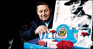 Barry Antill, of the City of Lismore RSL sub-branch, selling poppies at the Goonellabah Shopping Centre for Remembrance Day tomorrow.