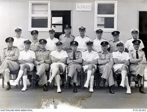 c1965DescriptionFormal portrait of RAN and RAAF officers at the RAN/RAAF Australian Joint Anti-Submarine School (AJASS) at HMAS Albatross at Nowra NSW. The only identified officer is O210106 Flight Lieutenant David Valentine Paul DFC RAAF at front row far left. Flt Lt Paul enlisted on 4 January 1941 and trained as a pilot with the Empire Air Training Scheme (EATS) in Rhodesia. He was posted to 454 Squadron RAAF. Flying a Baltimore aircraft from a base in North Africa he was shot down on 4 December 1943 during a sortie over the Mediterranean. Rescued from the sea he became a prisoner of war (POW) of the Germans, finally being released in 1945 at Stalag IVb POW camp in 1945 at Muhlberg, Germany. He joined the NSW Police Force after the war and remained in the RAAF Reserve rising to the rank of Squadron Leader.