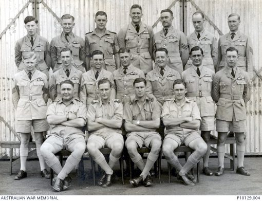 c1942DescriptionFormal group portrait of recent graduates of an Empire Air training Scheme (EATS) pilot training course in held in Rhodesia. The only identified man is 403215 (O210106) Sergeant, later Flight Lieutenant (Flt Lt) David Valentine Paul DFC who like all the new pilots standing in the rear and middle rows is wearing his newly presented wings. Flt Lt Paul enlisted on 4 January 1941 and trained with the Empire Air Training Scheme (EATS) in Rhodesia. Posted to 454 Squadron RAAF he was flying a Baltimore aircraft from a base in North Africa when he was shot down on 4 December 1943 during a sortie over the Mediterranean. Rescued from the sea he became a prisoner of war (POW) of the Germans, finally being released in 1945 at Stalag IVb POW camp in 1945 at Muhlberg, Germany. He joined the NSW police Force after the war and remained in the RAAF Reserve rising to the rank of Squadron Leader. The four men sitting are probably the course flying instructors.