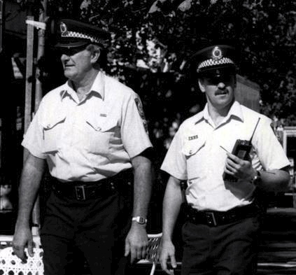 25 Feb 1985: Police At Kings Cross -- Sgt Ray Rickwood and Const Steve Colman, pictured walking the beat around Kings Cross. Pics show various sections of Kings Cross and also Macleay Street. Sgt Rickwood is the taller man.