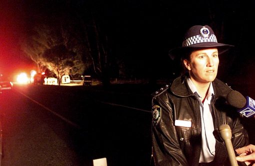 Margaret Majella SAUNDERS; Marg SAUNDERS At the front line: As an acting Inspector, Marg Saunders addresses the media at the scene of a fatal bus crash at Splitters Creek in 2002.