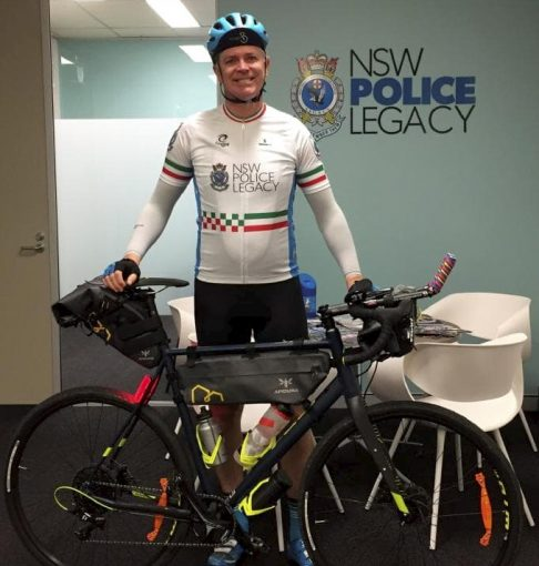 Senior Constable Anthony New at Newtown Police Station rides his bike cross country for his colleague battling cancer.