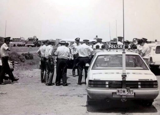 This picture is of John Hardaker and other officers. Location - Broken Hill, Mitch Hardaker, Johns son, was told that this was taken whilst Mad Max 3 was being filmed out there. You can see the old bus on the left of the picture.