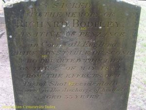 Inscription:Sacred to the memory of Richard BODLLEY, a native of Penzance, in Cornwall, England.Chief Constable of Scone, who departed this life on the 7th of May 1854, from the effects of a Pistol Shot accidentally recieved in the discharge of his duty.Aged 33 years.