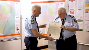 NSW Police Commissioner, Mick FULLER # 24552 presenting the Certificate of Service to retiring Senior Sergeant John THOMPSON # 10718 at the Planning Unit, on Friday 15 May 2020.