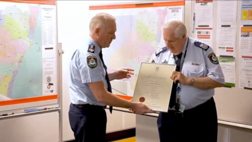 NSW Police Commissioner, Mick FULLER # 24552 presenting the Certificate of Service to retiring Senior Sergeant John THOMPSON # 10718 at the Planning Unit, Parramatta, on Friday 15 May 2020.